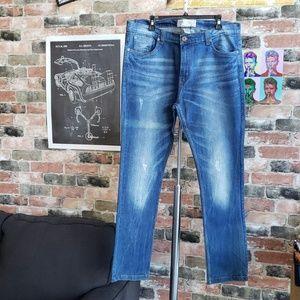 Men's distressed blue jeans by Alexander Julian